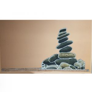 A Tower Of Pebbles On Bronze Mirror